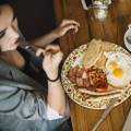 overhead-view-of-woman-having-healthy-breakfast-in-caf_23-2147871283.jpg