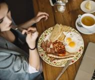 overhead-view-of-woman-having-healthy-breakfast-in-caf_23-2147871283.jpg